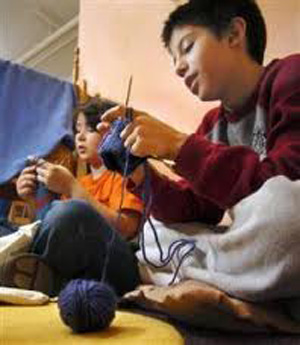 who_knits_young_boy_knitting