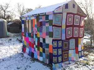 yarn_bomb_outhouse